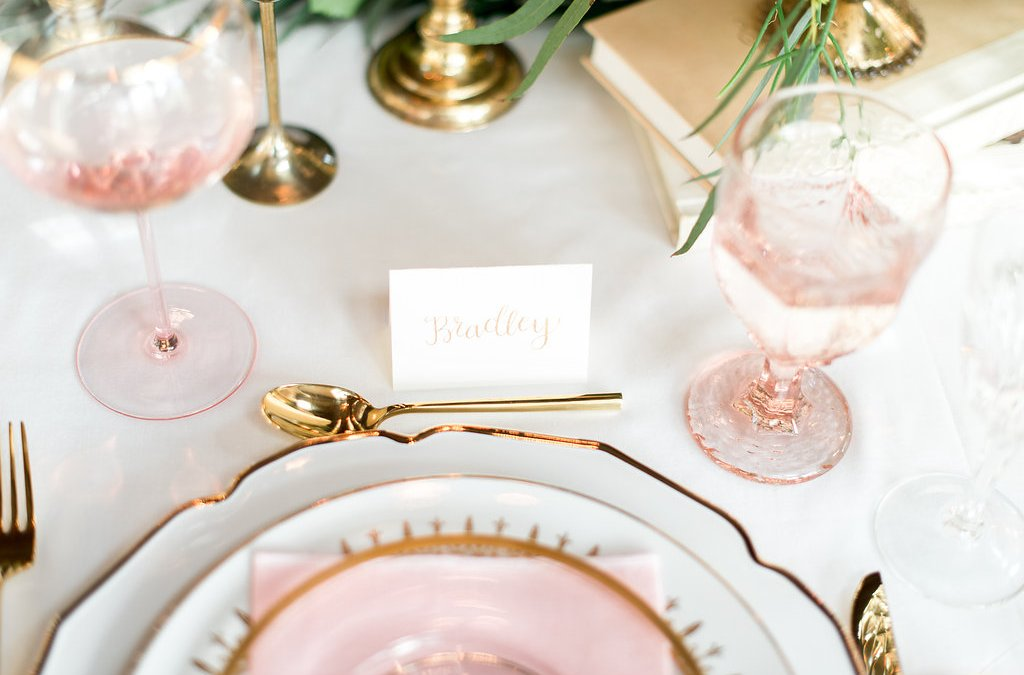 What is the difference between a place card and an escort card?