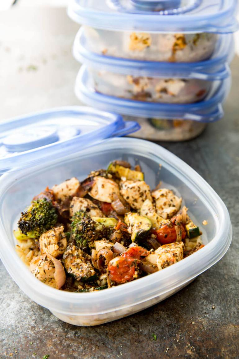 Easy Italian Chicken Meal Prep Bowls: Brown rice, zucchini, broccoli, tomatoes, and red onion, as well as deliciously seasoned chicken all cooked on a sheet pan for low mess, big flavor, meal prep!