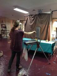 Nancy painting a still life demo