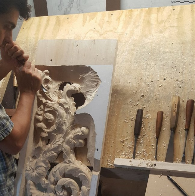 carving a panel trophy in lime wood by Laurent Robert woodcarver