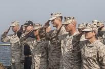 Marines saluting