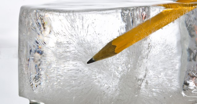 ice cube with pencil symbolizes writer's block