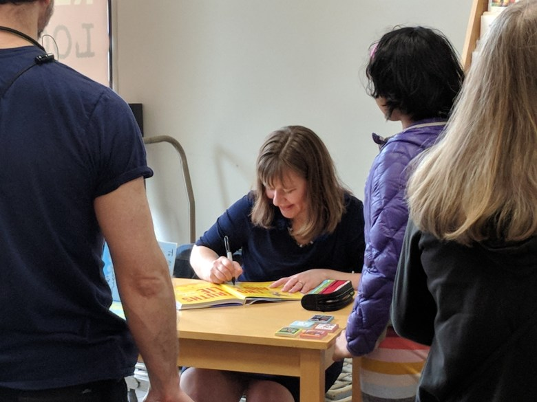Laurie Ann Thompson signing a book