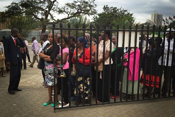 women lining up for cell phone cervical cancer screenings (photo by Abigail Higgins)