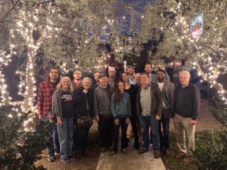 California Public Banking advocates standing under holiday lights