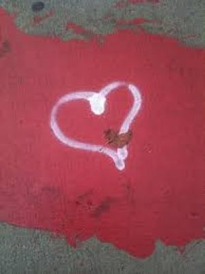 drawing of a heart with a kitten inside the very bottom