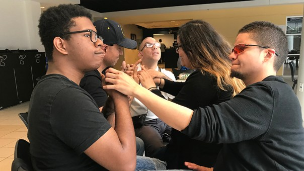 students of color at Gallaudet University in a ProTacticle workshop
