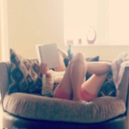 The littlest sister reading in my favourite chair