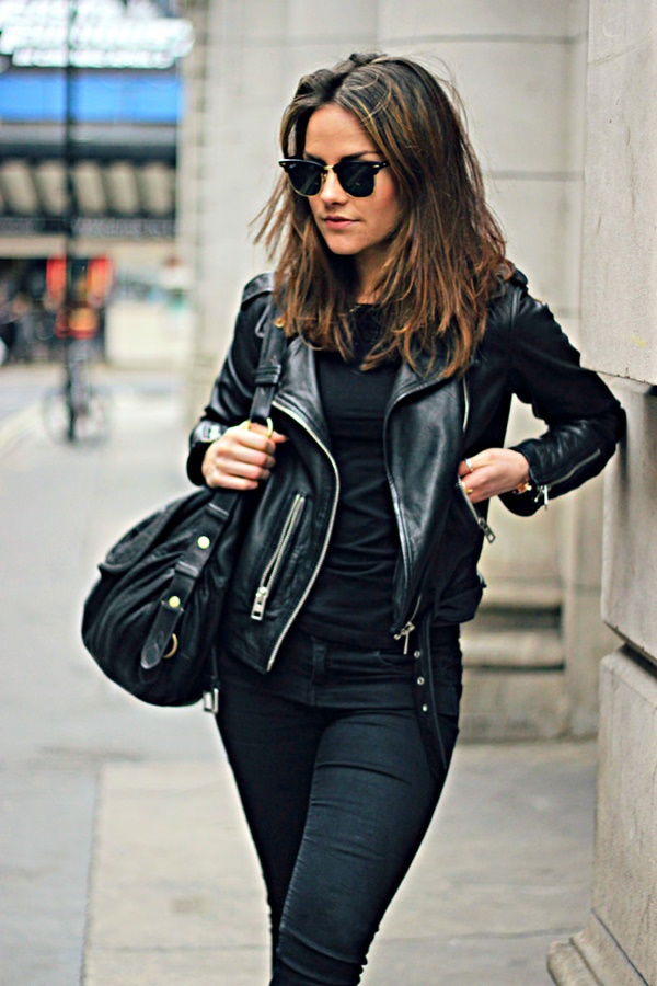 Black jeans with black top and black jacket