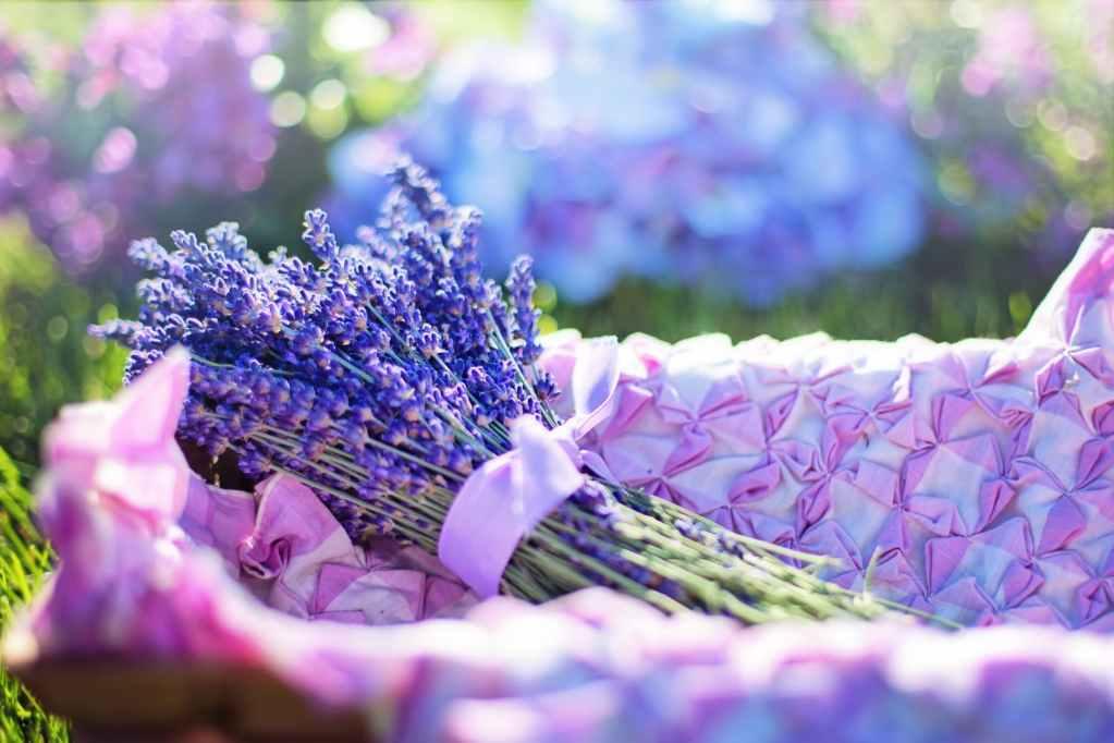 focus photo of lavender on basket