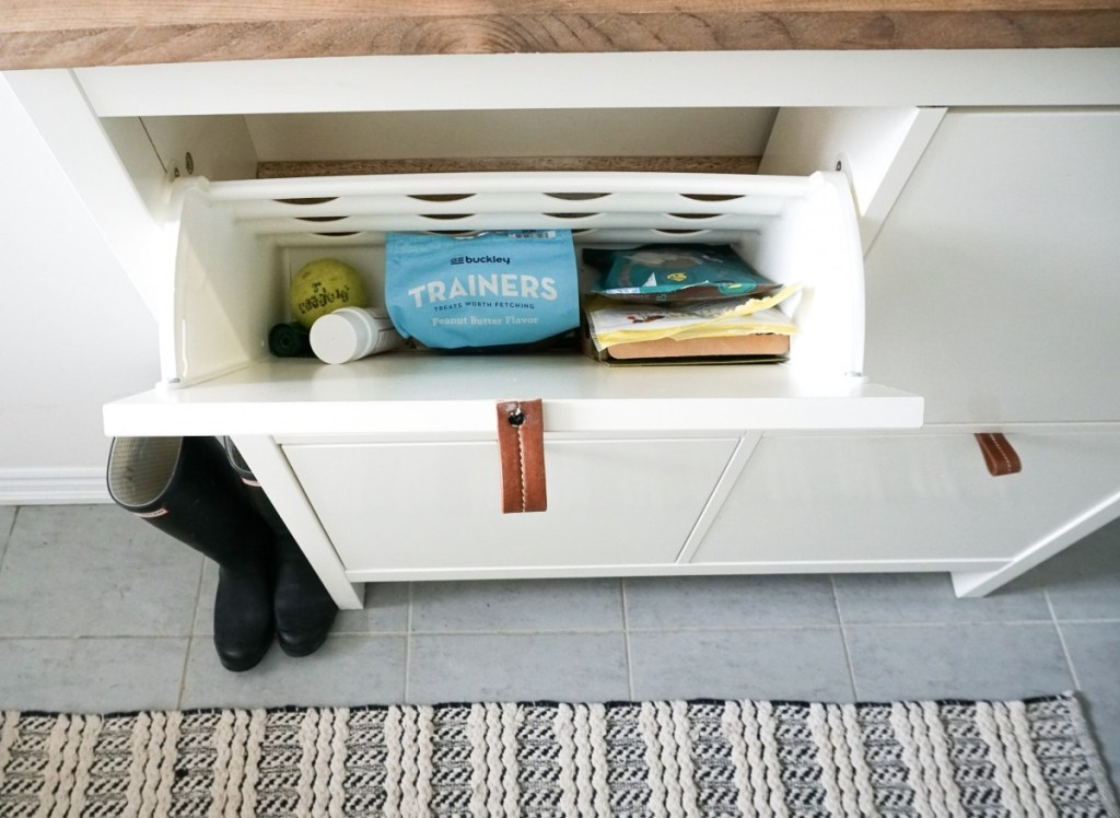 Ikea shoe cabinet that holds dog treats and supplies!