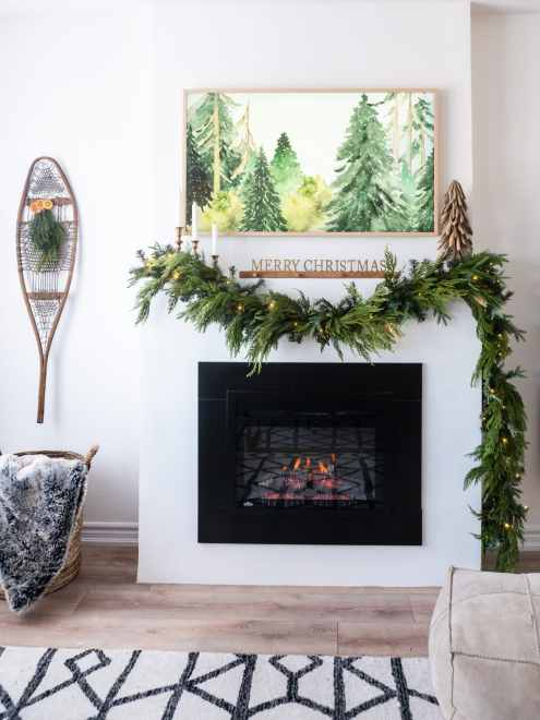 shoeshoe decor and white fireplace mantle with garland