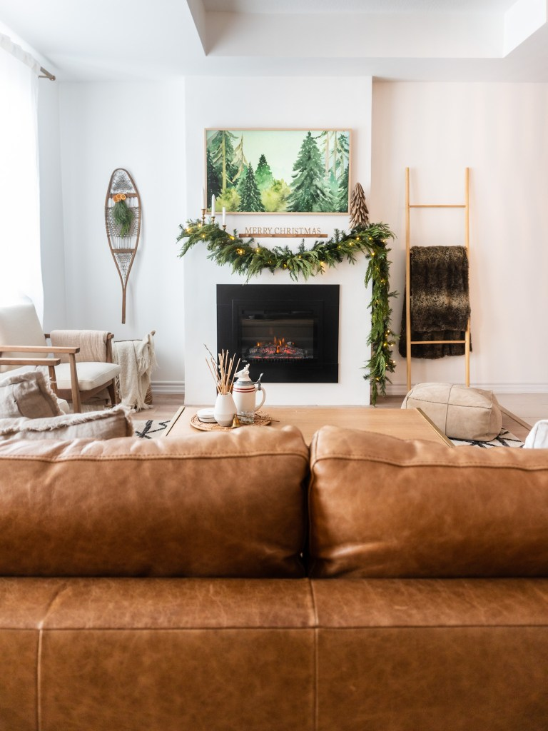 bohemian christmas living room fireplace and mantle with leather couch