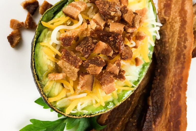 avocado baked with eggs, cheese and bacon