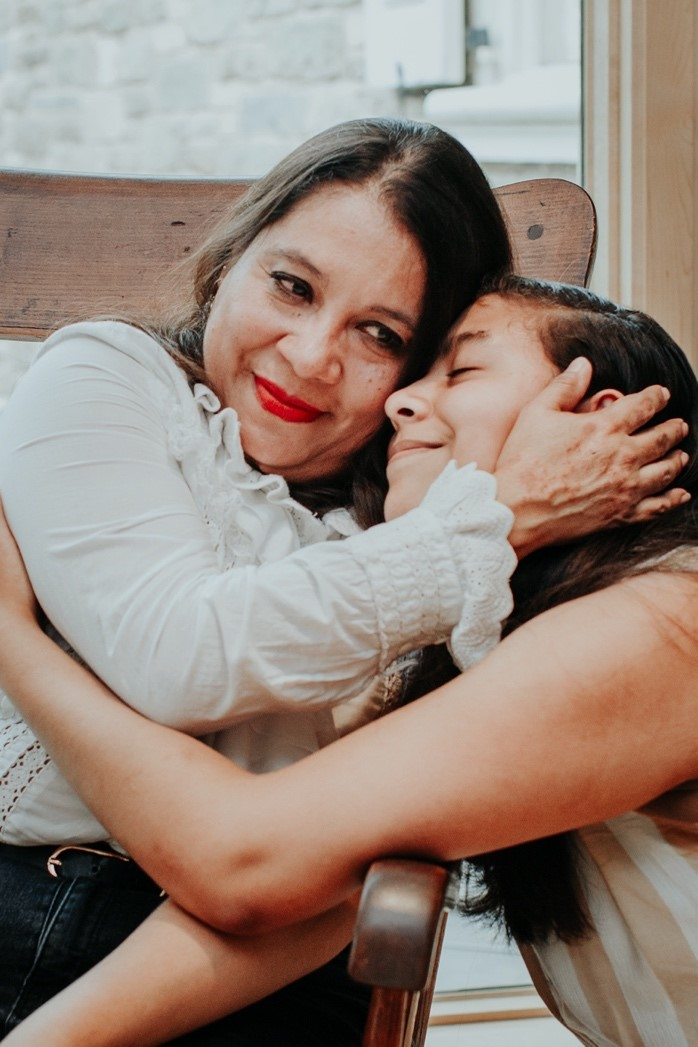 Liliana Pastora Rodriguez Montero hugs her daughter