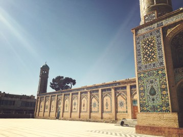 Most visitors enter the mosque through a park, which leads to a richly tiled facade.