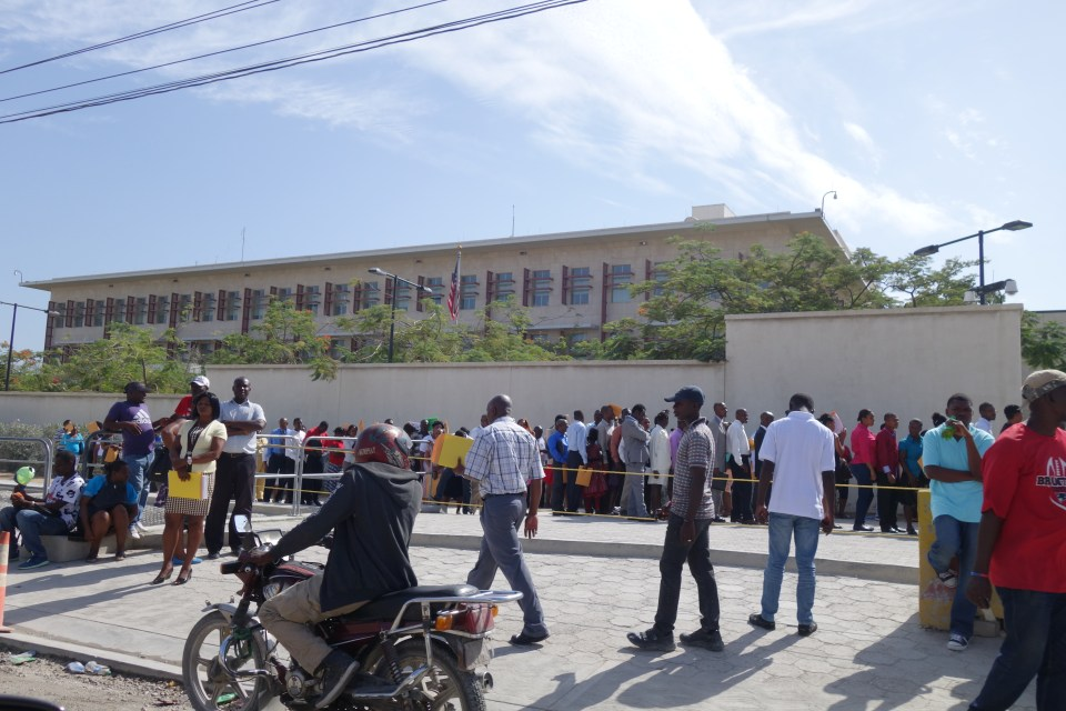 Haitians lined up outside the new US Embassy building in Port-au-Prince, awaiting visas.  © Malick W. Ghachem, 2016.