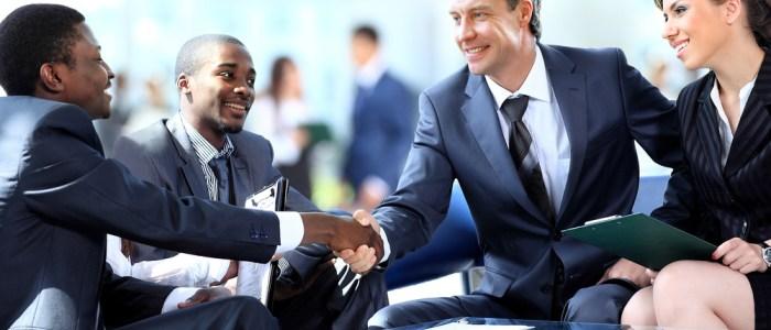 Business men shake hands on deal