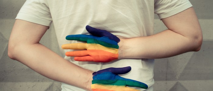 man with rainbow painted hands