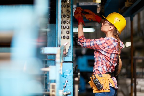 female engineer in hard hat working