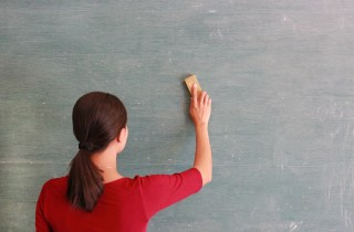 woman erasing chalkboard