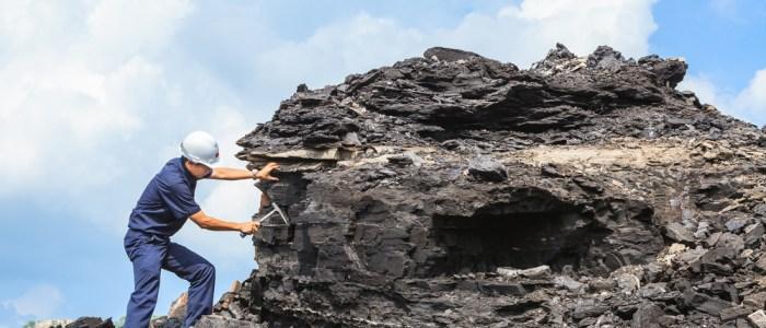 geologist studies rock