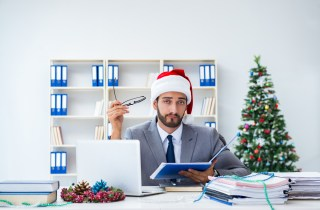 miserable employee with santa hat