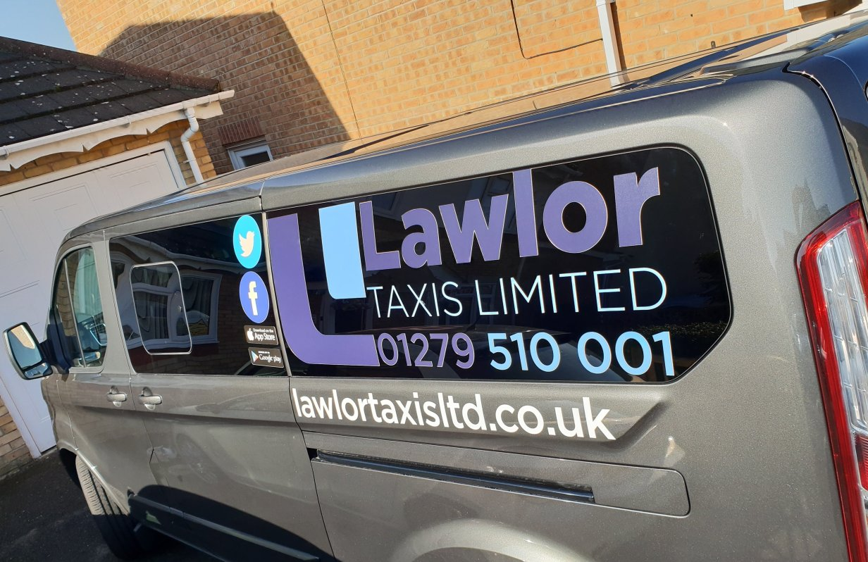 Lawlor Taxis 9 Seater Minibus Sign written