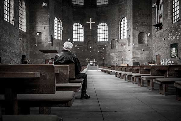 image of childhood sexual abuse victim in church, clergy abuse by priests and ministers