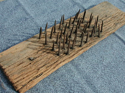 Image result for booby trap with nails