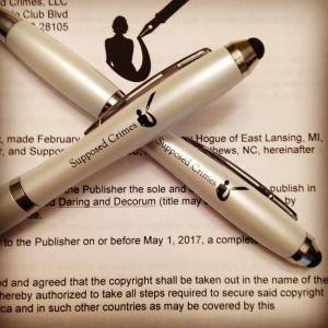 Photo of pens and contract with Supposed Crimes