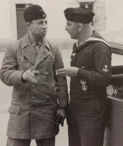 Haring (left) talks to Rudolf Meisinger, another Propaganda Kompanie reporter and veteran of U-boats and minesweeper patrols.
