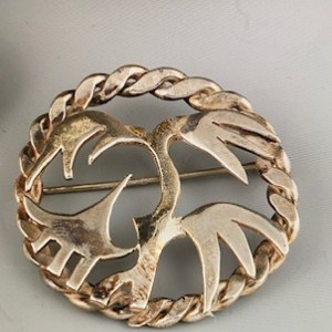 "Alice Frank, Sterling silver hand carved pin 2 1/2 "" $100"