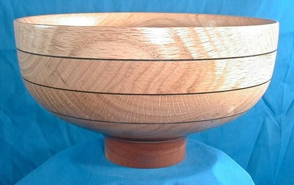 "Dennis Montville, ""Easily Explained"" - This is a segmented bowl made by simply stacking pieces of oak like pancakes with some thin dyed veneer between and adding a mahogany foot. See how easy that was to explain?, wood turning, 5 x 9, $85"