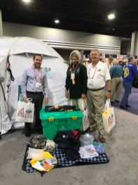 Craig Roberts, David Freeman and Nina E. Freeman are at the International Rotary convention looking at the contents of a Shelter Box. Rotary Club of Lawrenceville supports this project to get immediate shelter to those who have experienced a natural disaster.