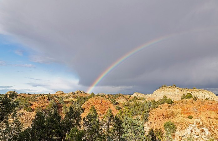 A rainbow over badlands in ND.