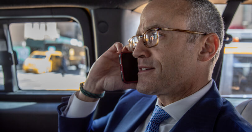 attorney john damashek on the phone with client
