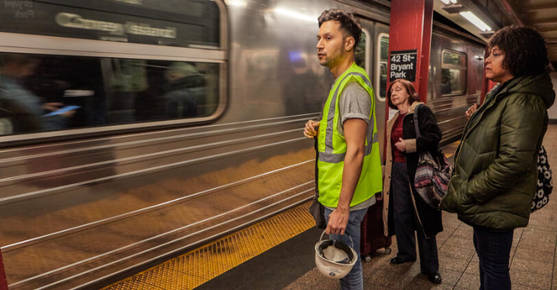 construction worker waiting for the subway