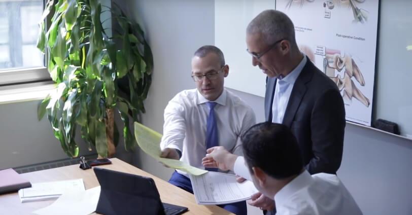 attorneys jordan hecht, judd kleeger and jonathan damashek reviewing the details of an injury