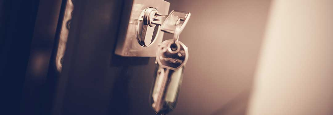 A key in an unlocked door to indicate a spouse leaving the conjugal home.