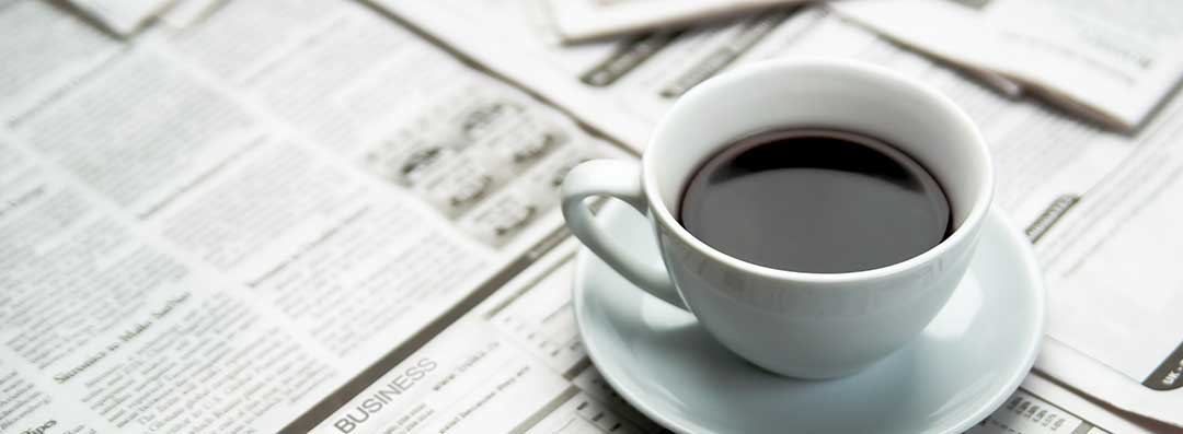 A coffee cup over a newspaper to indicate that publication in a newspaper is one of the requirements of probate.