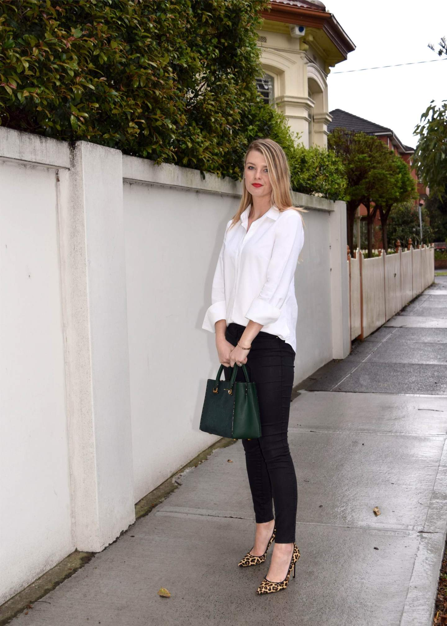 121dee2a436 Wear your staple white shirt with a pair of casual pants or jeans. Try  rolling up the sleeves and leaving the shirt untucked for a more relaxed  look.