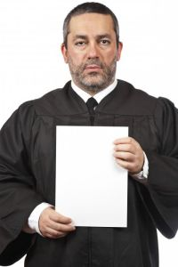 Serious judge holding the blank card