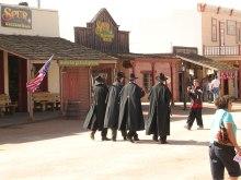 Men in the Black Trenchcoats