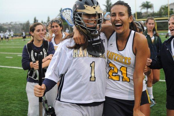 La Costa Canyon High's Jackie Candelaria, right, and Sam Slavinsky celebrate their win over Rancho Bernardo in the CIF San Diego Section girls lacrosse semifinals on Thursday. (Photo by John Koster - For the North County Times)