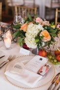 Ivory and peach wedding florals. Accents of peaches and grapes
