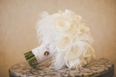 White bridal bouquet with white feather accents