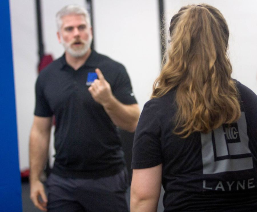Dr. Layne coaching a client at Layne Performance, Gainesville's premiere sport performance and weightlifting gym