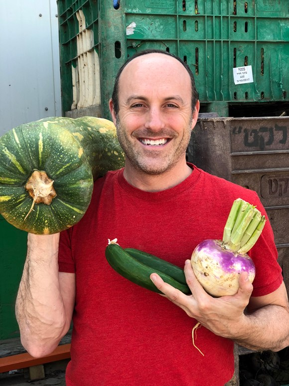 Joseph Gitler with rescued produce.  Photo courtesy Leket Israel
