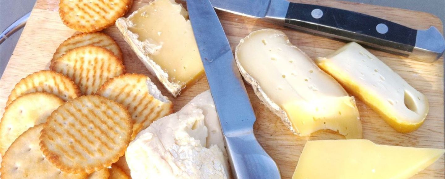 A fabulous French cheeseboard with a glass of Brittany cider, Lay The Table